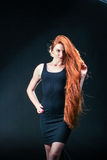 Beauty ginger Girl Portrait. Healthy Long Red Hair. Beautiful Yo Stock Photos