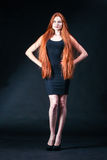 Beauty ginger Girl Portrait. Healthy Long Red Hair. Beautiful Yo Stock Photo