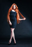 Beauty ginger Girl Portrait. Healthy Long Red Hair. Beautiful Yo Royalty Free Stock Photography