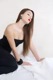 Beauty girl. Sitting on white sheet Stock Photo
