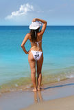 Beauty Girl. In white swim suite and hat stock photography