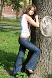 The beauty girl. Standing near a tree Stock Photos