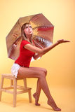 Beauty girl. With umbrella on a yellow background Royalty Free Stock Photography