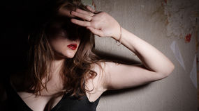 Beauty Girl And Grunge Wall Royalty Free Stock Photos