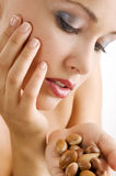 Beauty girl with argan seed Stock Photo
