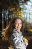 Beauty girl in autumn park Stock Images