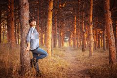Beauty girl in autumn park. Standing near a tree Royalty Free Stock Images