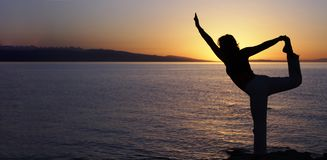Beauty girl on beach in yoga pose, relax silhouette.  royalty free stock images