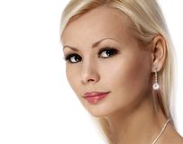 Beauty girl. Beautiful face. Glamour blonde woman with diamond jewelry isolated Royalty Free Stock Photos