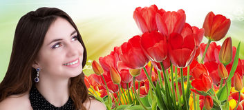 beauty Girl with Beautiful garden fresh colorful tulips Stock Images