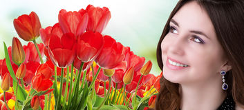 Beauty Girl with Beautiful garden fresh colorful tulips Royalty Free Stock Images