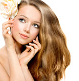 Beauty Girl. Beautiful Model with Rose Flower Royalty Free Stock Images