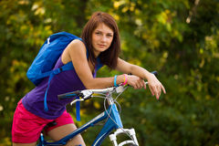 Beauty girl on bike in summer day Royalty Free Stock Photo