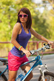 Beauty girl on bike in summer day. Outdoors Royalty Free Stock Photography