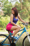Beauty girl on bike in summer day. Outdoors Royalty Free Stock Photo