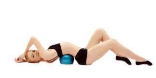 Beauty girl in black cloth lay on gymnastic ball Stock Images