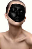 Beauty girl with black face on white skin Stock Image