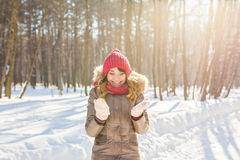 Beauty Girl Blowing Snow in frosty winter Park. Outdoors. Flying Snowflakes. Royalty Free Stock Photography