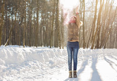 Beauty Girl Blowing Snow in frosty winter Park. Outdoors. Flying Snowflakes. Stock Photo