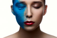 Beauty girl with blue face and red lips Stock Photography