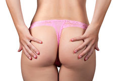 Beauty girl Booty in pink string over white Royalty Free Stock Photos
