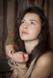 Beauty girl with bound hands. Beautiful young woman with bound hands In the hope of looking up Stock Images