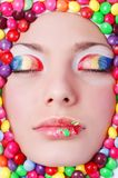 Beauty girl in candies. Portrait of young beauty girl in candies Royalty Free Stock Image