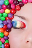 Beauty girl in candies Stock Image