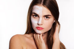 Beauty girl with clay face pack, spa concept Royalty Free Stock Images