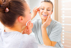 Beauty girl cleaning her face with cotton pads Royalty Free Stock Photo