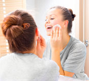 Beauty girl cleaning her face with cotton pads Royalty Free Stock Images