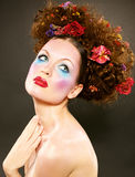 Beauty girl with colored fashion makeup Royalty Free Stock Photography