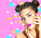 Beauty girl with colorful makeup. Nail polish and accessories Stock Images