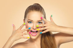 Beauty girl with colorful nail polish Stock Images