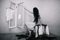 Beauty girl cuting her hair in empty fearing room Royalty Free Stock Photo