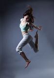 Beauty girl dance on grey background Royalty Free Stock Photography