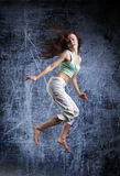Beauty girl dance on grunge background Stock Photography