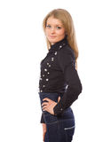 Beauty girl dressed in dark blue jeans Stock Photography