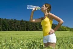Beauty girl drinks. Mineral aqua Royalty Free Stock Photo