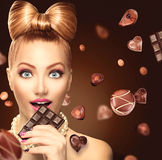 Beauty Girl Eating Chocolate Stock Images