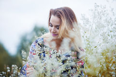 Beauty Girl enjoying nature, blond girl in dress. The young beautiful girl on a meadow Stock Image