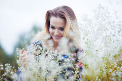 Beauty Girl enjoying nature, blond girl in dress. The young beautiful girl on a meadow Stock Photos