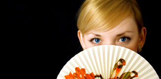 Beauty girl with fan Royalty Free Stock Images