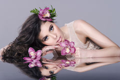 Beauty Girl With Flowers Stock Photos