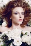 Beauty Girl With Flowers.Beautiful Model Woman Face. Perfect Skin. Professional Make-up.Makeup. Fashion Art Stock Photography