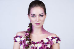 Beauty girl with flowers on the body Royalty Free Stock Photos