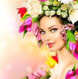 Beauty girl with flowers hairstyle. Beauty summer model girl with colorful flowers hairstyle Stock Images