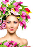 Beauty girl with flowers hairstyle. Beauty summer model girl with colorful flowers hairstyle Royalty Free Stock Images