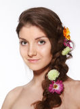 Beauty girl with flowers in her hair Stock Image