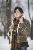 Beauty Girl in frosty winter Park. Outdoors. Flying Snowflakes. Royalty Free Stock Photo